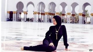 Rihanna outside the Sheikh Zayed Grand Mosque Centre