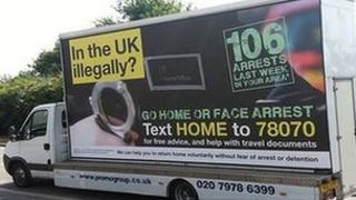 "Home Office van bearing the slogan ""In the UK illegally? Go home or face arrest"""
