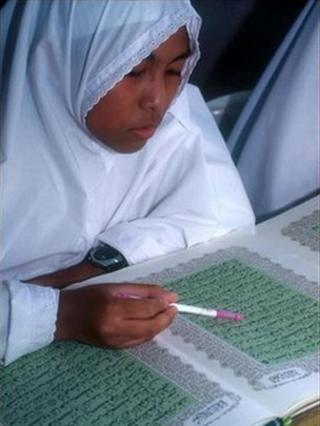 A Muslim girl studies the Koran at a Brunei school