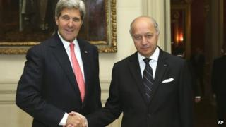 French Foreign Minister Laurent Fabius shakes hands with US Secretary of State John Kerry at the Foreign Affairs Ministry in Paris on 22 October 2013