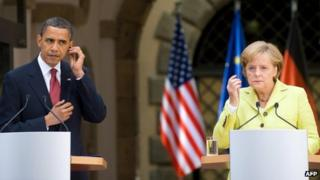 This picture taken on June 5, 2009 shows US President Barack Obama and German Chancellor Angela Merkel listening to translations during a press conference at Dresden Castle in the centre of the eastern German town of Dresden
