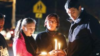 Parents and students hold candlelight vigil to at Danvers High School, on 23 Wednesday 2013