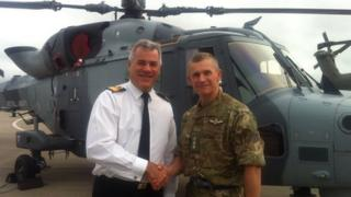 Commodore jock Alexander of RNAS Yeovilton and Col Neil Dalton from the army's Aviation Reconnaissance Force with a Wildcat helicopter behind them