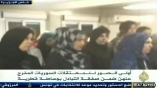 Frame from Al-Jazeera video purported to show freed Syrian women (24/10/13)