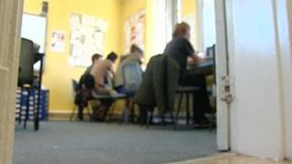 Women working at computers in HMP Styal
