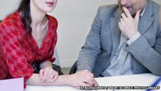 Couple talking to a doctor about fertility issues