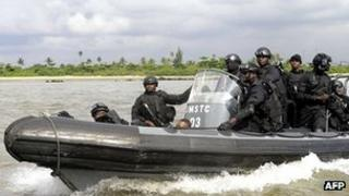 Nigerian navy special forces patrol against pirates.