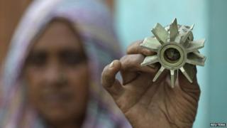 A villager shows a mortar shell that locals say was fired from the Pakistan side of the international border, at Garkhal village, about 35 km (22 miles) from Jammu October 25, 2013.