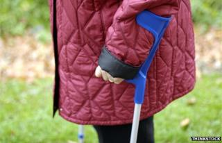 Detail of woman walking with crutches
