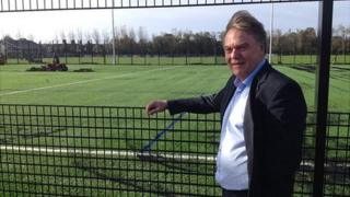 Graham Chester, from Guernsey Sports Commission, by 3G pitch at KGV playing fields