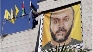 Banner showing Palestinian prisoner Moses Qaran in Ramallah