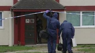 Forensic officers at scene of murder in 2004