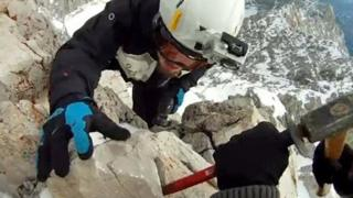"""Screengrab from YouTube video of mountain summit """"theft"""""""
