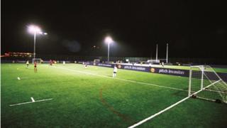 A floodlit football pitch