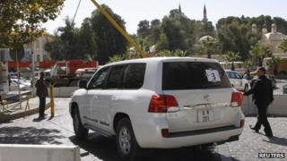 UN vehicles transporting a team of experts from the Organisation for the Prohibition of Chemical Weapons (OPCW), leave their hotel in Damascus on 22 October, 2013