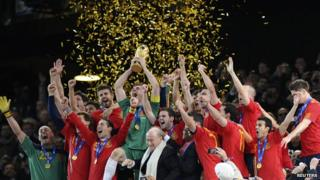Spanish team holds up World Cup trophy