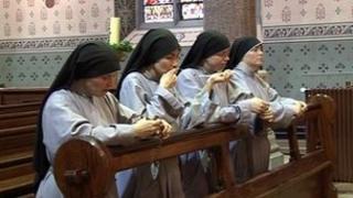 Four nuns praying