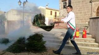 Francesco Mura makes his smoke signal protest