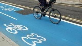 Person riding a bicycle on a Barclays Cycle Superhighway