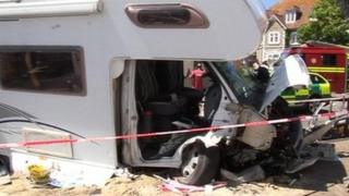 Police cordon surrounds crumpled front of motorhome