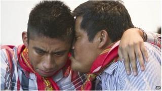 Alberto Patishtan kisses his son Hector