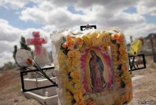 Graves in a cemetery in Juarez neighbourhood where many of the deceased are victims of violent crime