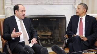 Iraqi Prime Minister Nouri Al-Maliki (L) speaks with US President Barack Obama in the Oval Office at the White House 1 November 2013