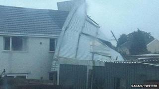 A garage blew onto a house in Beddau near Pontypridd