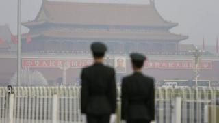 Paramilitary police officers stand guard near Tiananmen Gate in Beijing, 28 October, 2013