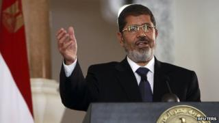 Mohammed Morsi during a news conference at the presidential palace in Cairo (31 July 2012)