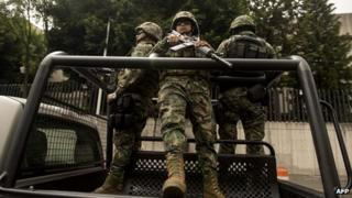Mexican Navy marines on patrol in Mexico City on 16 July, 2013