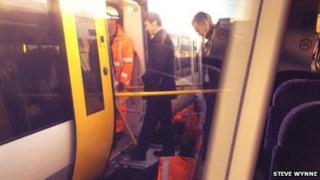 Passengers using a ramp linked to rescue train at Tonbridge station