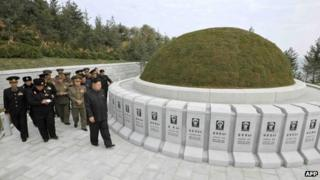 Undated picture released by North Korea's official Korean Central News Agency (KCNA) on 2 November 2013 shows North Korean leader Kim Jong-un (front R) visiting the cemetery of fallen fighters of the KPA Navy Unit 790 at an undisclosed location in North Korea