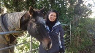 Cynthia Wong with one of the horses