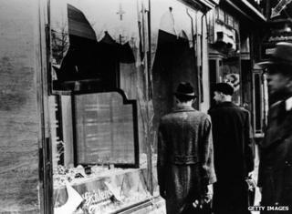 Broken windows of a Jewish business
