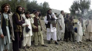 "In this file image taken on Oct. 4, 2009, Pakistan""s new Taliban leader Hakimullah Mehsud, center, operates light machine gun with his comrades in Sararogha in Pakistani tribal area of South Waziristan"