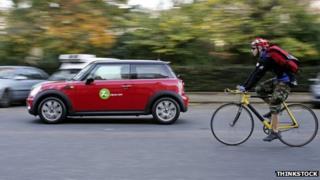 A car passing a cyclist