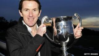 Tony McCoy poses with his trophy marking his 4,000th career victory at Towcester racecourse