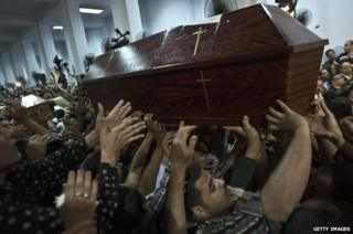 Mourners carrying coffins in Egypt