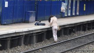 The woman preparing to get on the platform