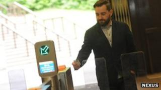 Man using automatic ticket gates