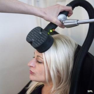 Woman having brain zap