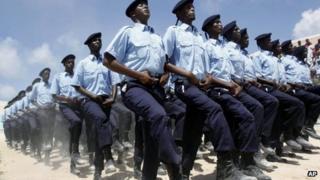 Somali policemen march during the Somalia's independence day at Konis stadium in Mogadishu - July 2013