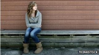 Teenage girl on bench