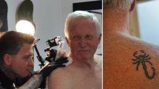 David Dimbleby at tattoo studio, and tattoo