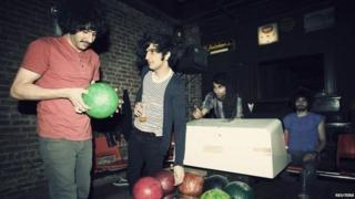 Members of the Yellow Dogs, (L-R) Soroush Farazmand, Koory Mirz, Siavash Karampour and Arash Farazmand are shown at The Gutter bowling alley in Williamsburg neighbourhood in New York in 2011