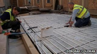 Workers lay new under-floor heating in Bath Abbey