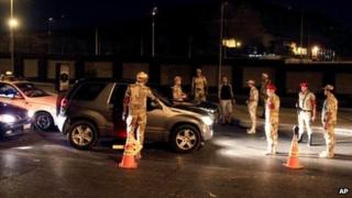Egyptian armed forces search vehicles at a checkpoint during curfew in Nasr City, Cairo, Egypt (19 August 2013)