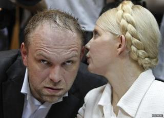 Yulia Tymoshenko (right) with her lawyer Serhiy Vlasenko in court in Kiev, June 2011