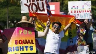 Supporters of same-sex marriage celebrate while the Hawaii State Senate convenes to approve the bill to legalise same-sex marriage in Honolulu, 12 November